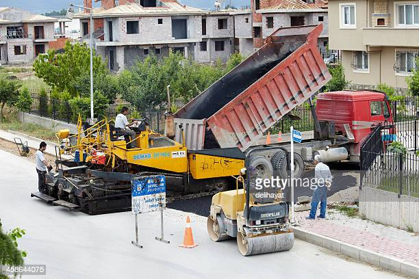 road construction - asphalt paving stock photos and pictures