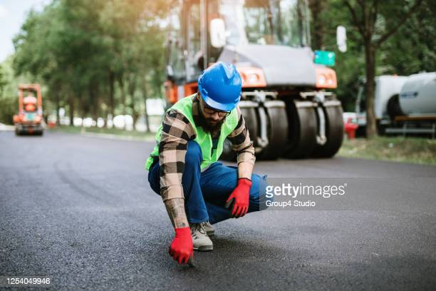 road construction worker on job - headwear stock pictures, royalty-free photos & images