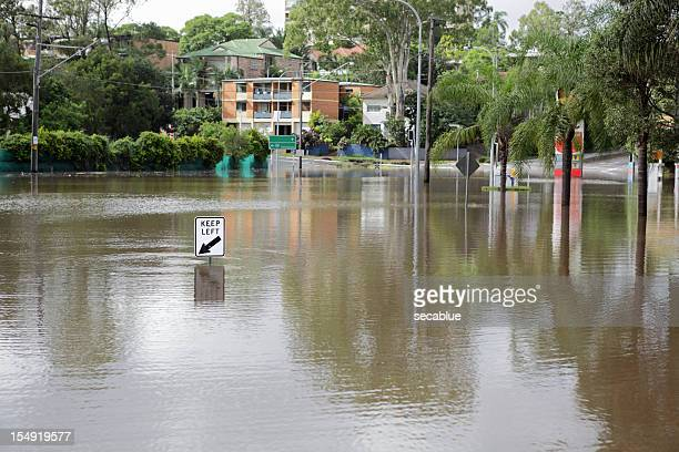 road covered by flood - flooding stock photos and pictures