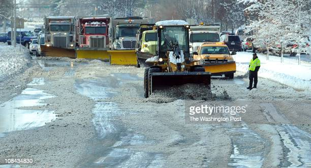 Road crews work to clear snow from a portion of Germantown Road on Tuesday January 27 2011 in Germantown Md The Washington region got hit with a 68...