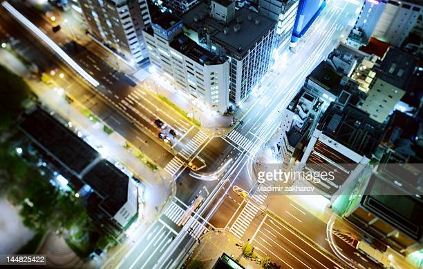 road crossing overhead view - overhead view of traffic on city street tokyo japan stock photos and pictures