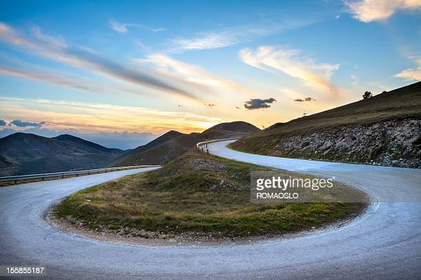 road curve near campo imperatore, abruzzi italy - hairpin stock pictures, royalty-free photos & images