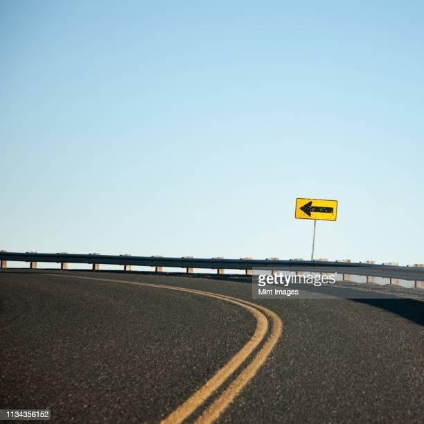 road curving left - curved arrows stock pictures, royalty-free photos & images