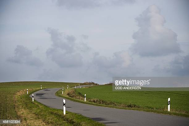 A road cuts through the fields in the green belt area outside the north German village of Thandorf on October 30 2014 The European Green Belt...