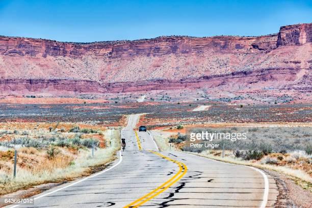 Road cutting through cliff face landscape,Utah,USA