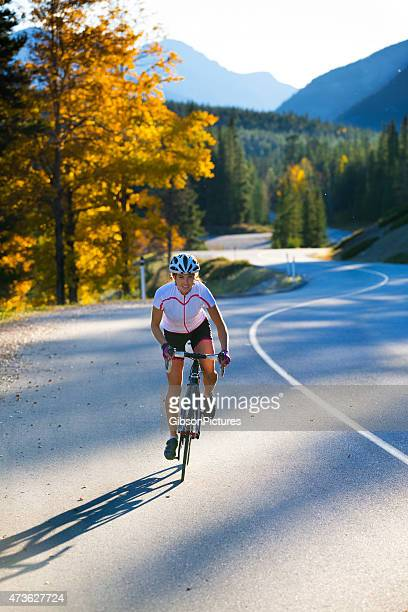 road cycling girl - s shape stock photos and pictures