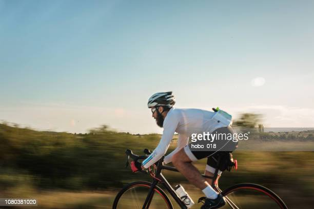 road cycling in the nature - road cycling stock pictures, royalty-free photos & images