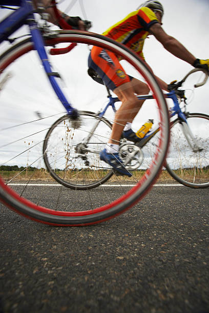Road Cyclist, Bicycle Wheel In Foreground (surface Level) Wall Art