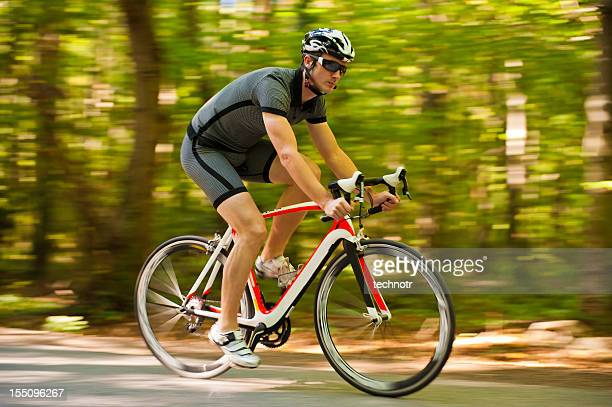 Road cyclist in the forest