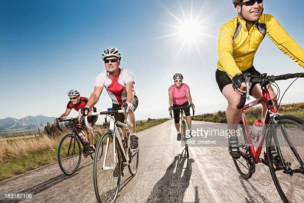 road cyclists riding together - riding stock pictures, royalty-free photos & images