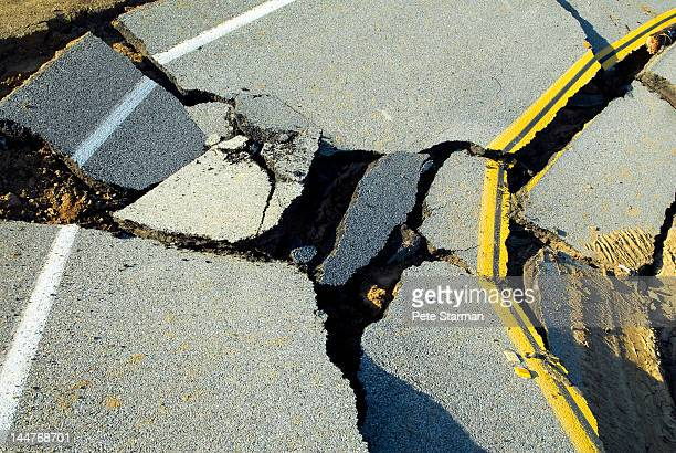 road destroyed by the effects of heavy rain - earthquake stock pictures, royalty-free photos & images