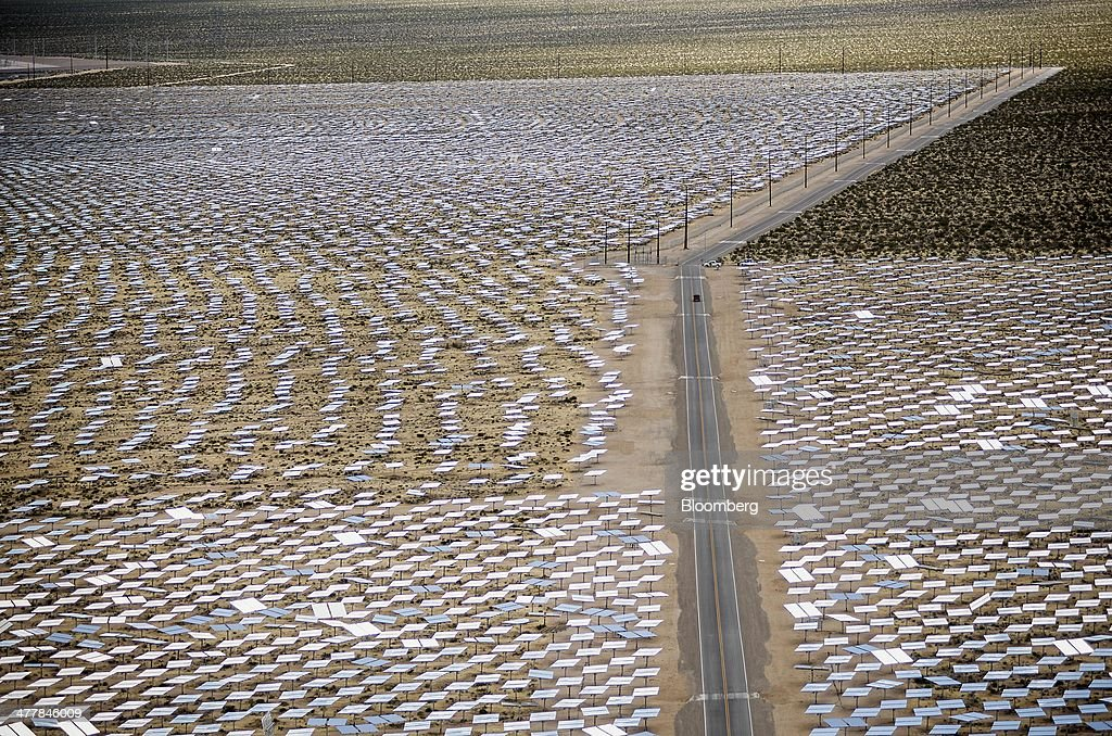 A road divides solar panels standing at the Ivanpah Solar Electric Generating System in the Mojave Desert near Primm, Nevada, U.S., on Monday, March 10, 2014. The 392-megawatt California Ivanpah plant developed by Google, NRG and Bright Source, which began operating in February, brings utility-scale solar to more than 5.5 gigawatts, up 1,089% since 2010. Photographer: Jacob Kepler/Bloomberg via Getty Images