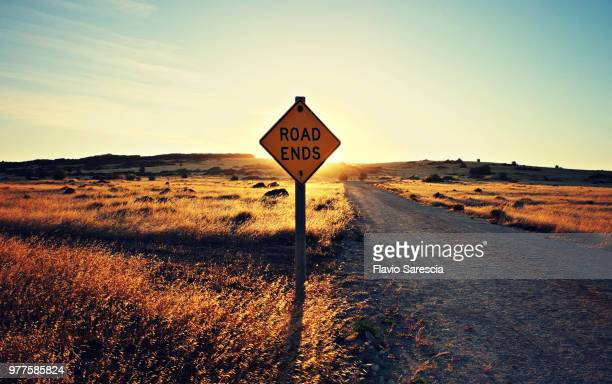 road end sign on remote dirt road at sunset, kangaroo island, south australia, australia - finishing stock pictures, royalty-free photos & images