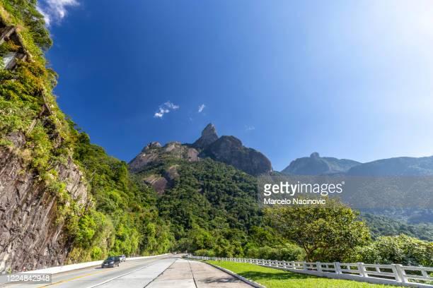road from rio de janeiro to teresopolis - marcelo nacinovic stock pictures, royalty-free photos & images
