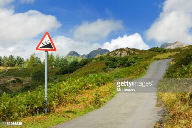 road going up hill - steep stock pictures, royalty-free photos & images