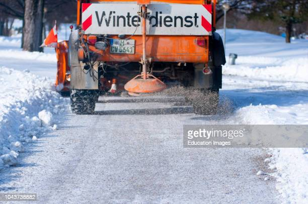 Road Gritter busy on the snow in Munichs Olympic park, Germany.