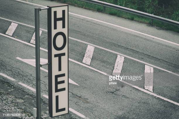 road hotel sign vertical with road