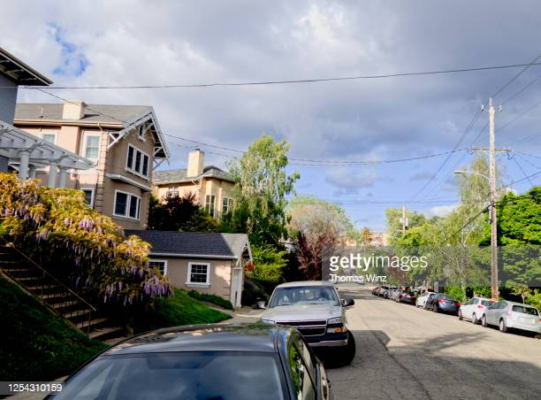 road in a residential neighborhood in oakland - oakland california stock pictures, royalty-free photos & images