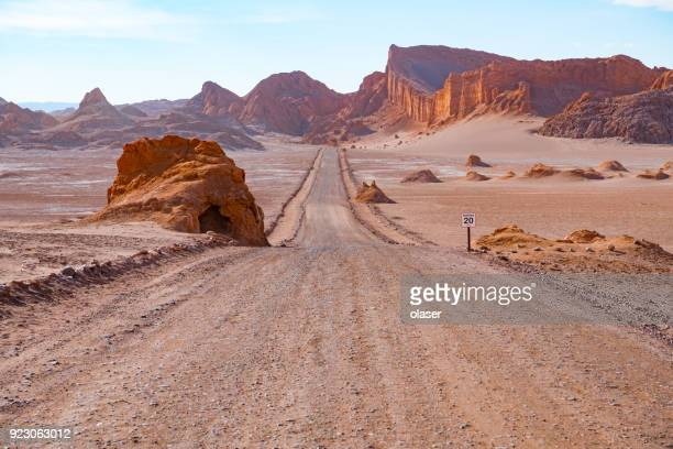 road in atacama desert - moon valley mountains - chile stock pictures, royalty-free photos & images