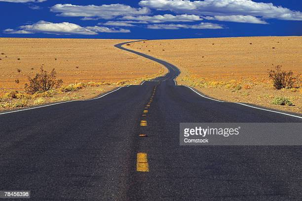 Road in barren landscape reaches vanishing point