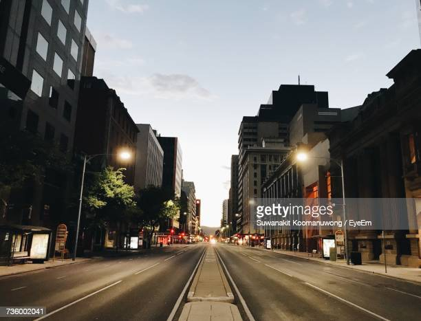 road in city against sky at sunset - south australia stock pictures, royalty-free photos & images