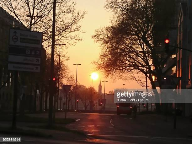 road in city against sky during sunset - lucht stock-fotos und bilder