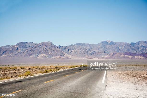 Road in Death Valley with distant mountain.