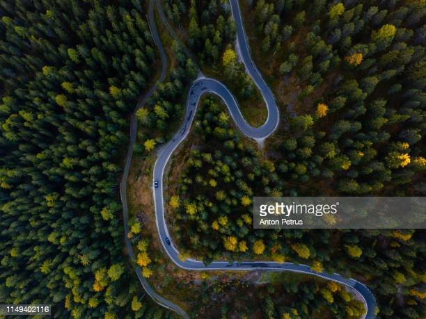 road in dolomites mountains, passo gardena, italy. aerial view - mountain pass stock pictures, royalty-free photos & images