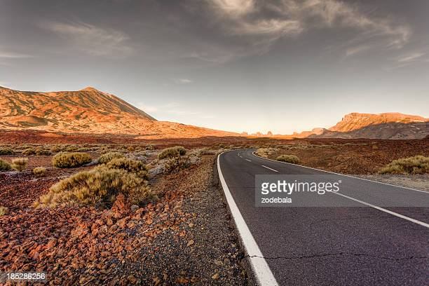 road in el teide national park at sunset - pico de teide stock pictures, royalty-free photos & images