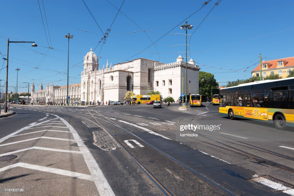 Road in front of the Jeronimos Monastery in Lisbon with moving buses : Stock Photo