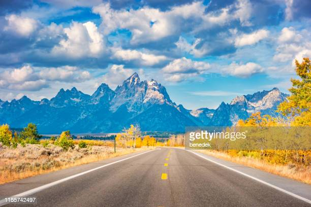 road in grand teton national park wyoming usa during autumn - jackson hole stock pictures, royalty-free photos & images