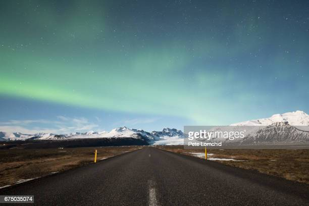 road in iceland with aurora