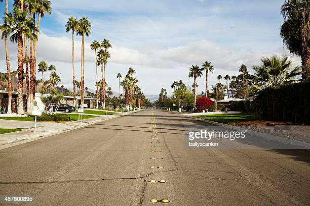 road in suburbia - palm springs california stock pictures, royalty-free photos & images
