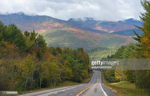 road in the adirondack mountains - lake placid stock pictures, royalty-free photos & images