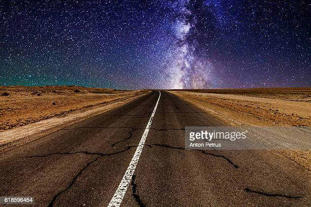 road in the desert at night with the milky way - nevada stock pictures, royalty-free photos & images