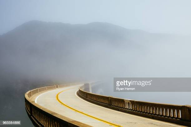 road in the morning fog - monterey peninsula stock pictures, royalty-free photos & images