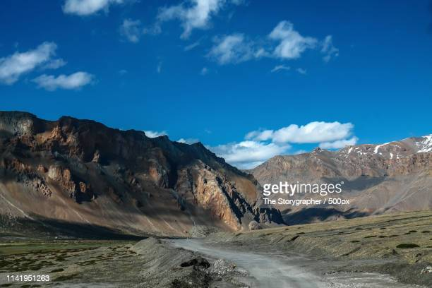 a road in the mountains - the storygrapher stock pictures, royalty-free photos & images