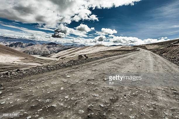road in tibet, china - rough stock pictures, royalty-free photos & images