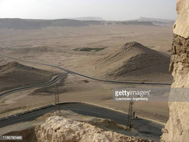 road intersections in desert landscape near palmyra - argenberg stock pictures, royalty-free photos & images