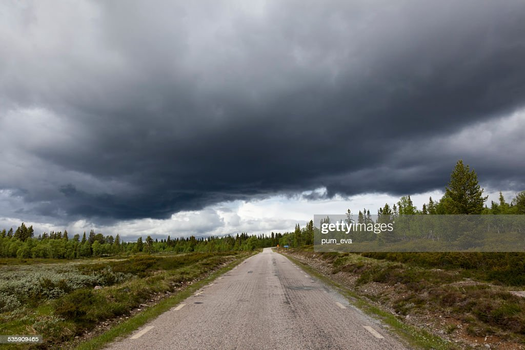 Road into the storm : Stock Photo
