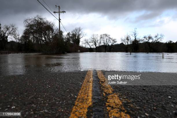 A road is blocked by floodwaters on February 15 2019 in Forestville California An atmospheric river a narrow corridor of concentrated moisture in the...