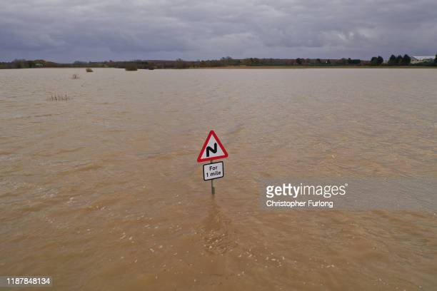 A road is completely submerged by floodwater at Bardney near Lincoln after the Barlings Eau broke its banks on November 15 2019 in Lincoln England...