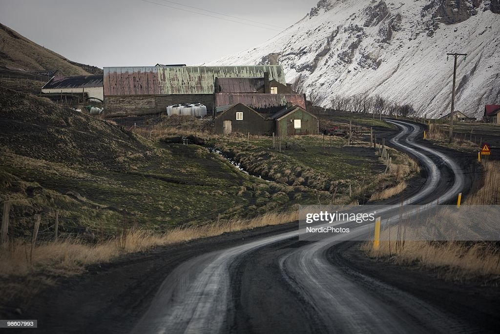 A road is covered by a thick layer of ash from the Eyjafjallajokull volcano, on April 21, 2010 in Skogar, Iceland. The ash is destroying pasture and polluting water supplies which is poisoning animals and is causing farmers severe financial difficulties.