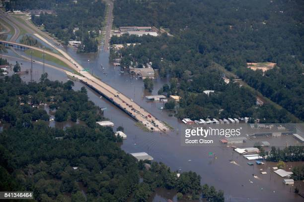 A road is covered by floodwater left in the wake of Hurricane and Tropical Storm Harvey on August 31 2017 near Houston Texas Harvey which made...