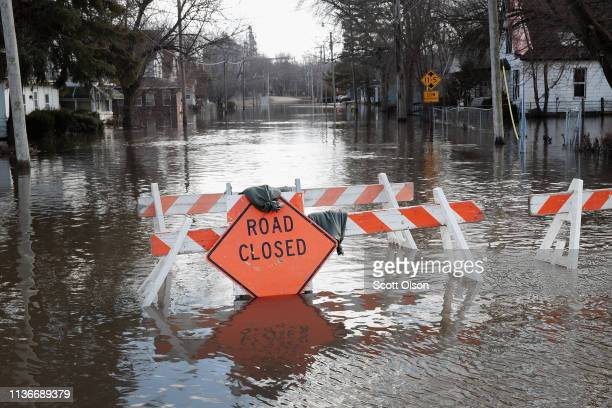 A road is covered with floodwater from the Pecatonica River on March 18 2019 in Freeport Illinois Several Midwest states are battling some of the...
