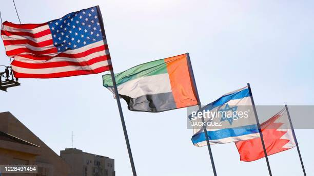 A road is decorated with the flags of the US the United Arab Emirates Israel and Bahrain in the resort city of Netanya in central Israel on September...