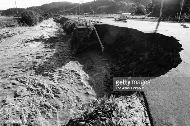 Road is eroded by a flooded river after Typhoon Bess hits across Japan on August 2, 1982 in Ureshino, Mie, Japan.