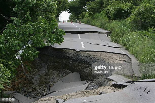 A road is heavily damaged by a magnitude 72 earthquake hit on Saturday in northern Japan on June 15 2008 in Oshu Iwate Japan At least 6 people died...