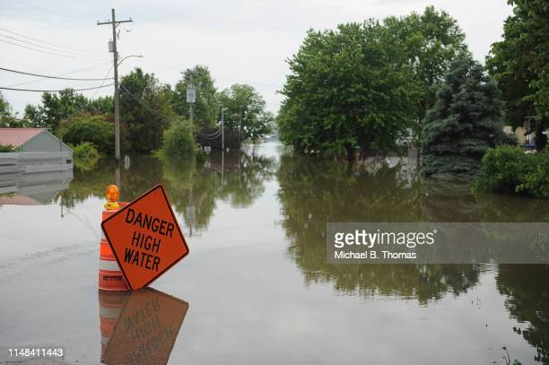 A road is seen submerged in floodwaters on June 6 2019 in Grafton Illinois Residents along Mississippi river are bracing for the expected arrival of...