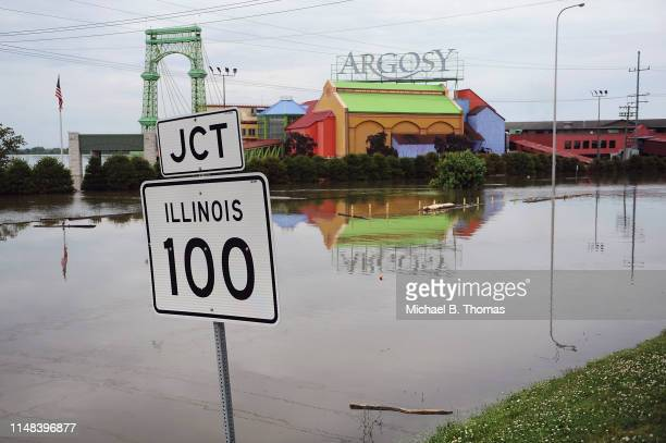 A road is submerged in floodwaters on June 6 2019 in Alton Illinois Residents along the Mississippi River are bracing for the expected arrival of the...